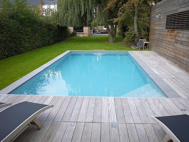Zwembad in houten best foto van procopi cerland tropic for Zwembad half inbouw
